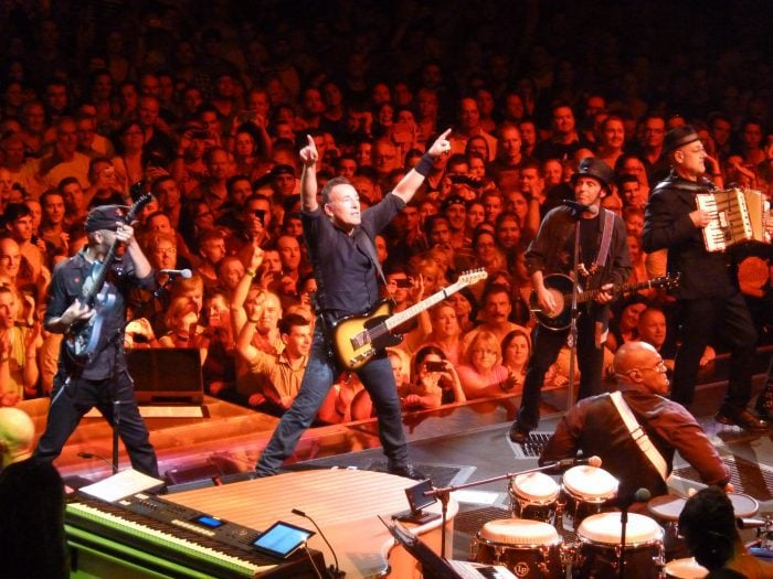 Bruce Springsteen and the E Street Band playing a concert.