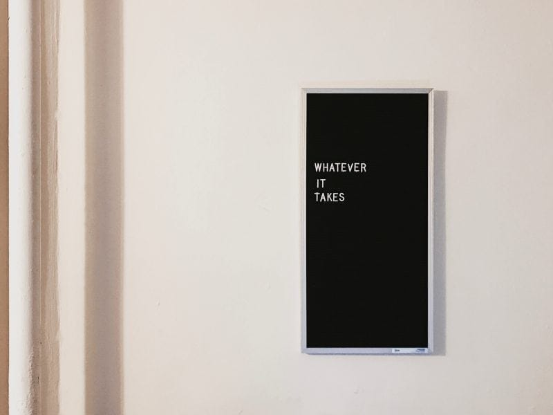 Whatever it takes typography on black felt board frame on white wall