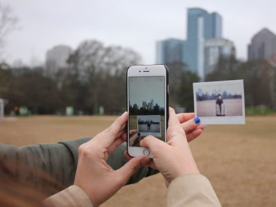 Person taking a photo of a photo