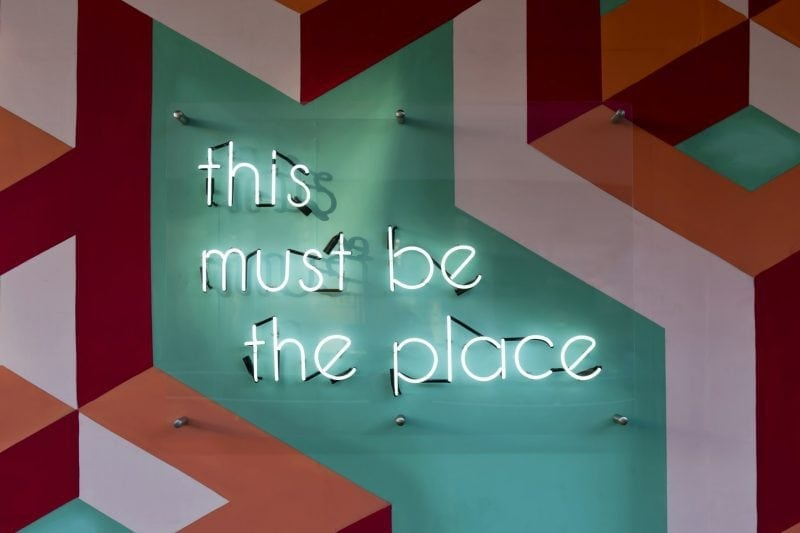 """Neon sign saying """"This must be the place"""""""