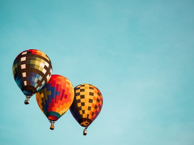 three hot air balloons