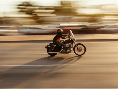 time lapse photography of man riding motorcycle