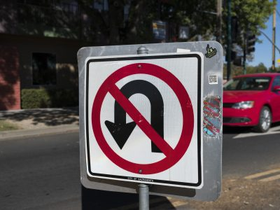 """No U turn"" street sign."