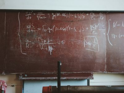 mathematical formulas on an old blackboard
