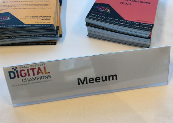 Meeum name tag on a desk
