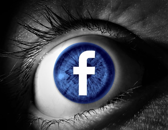 Facebook logo superimposed over an eye