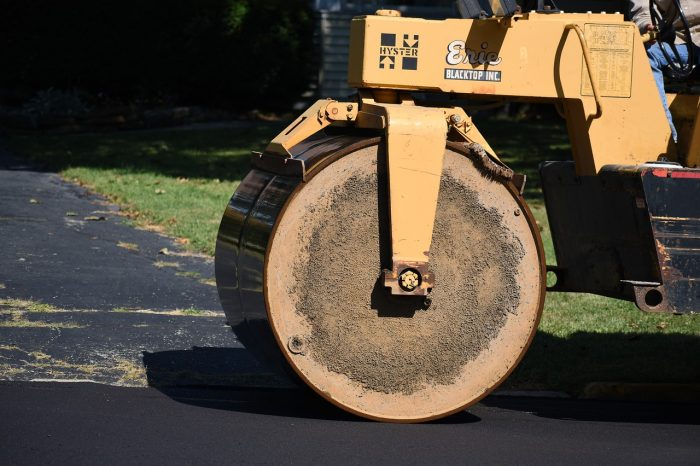 steamroller compressing bitumen