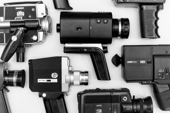 assorted camera lot on surface n grayscale